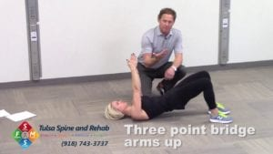 Fit Tip: Three-Point Bridge – Arms Up
